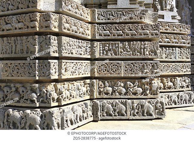 Shrine wall relief sculpture follows a stellate plan, depicting Swans, makara(imaginary beast), Hindu puranas, foliage, horsemen and elephant procession