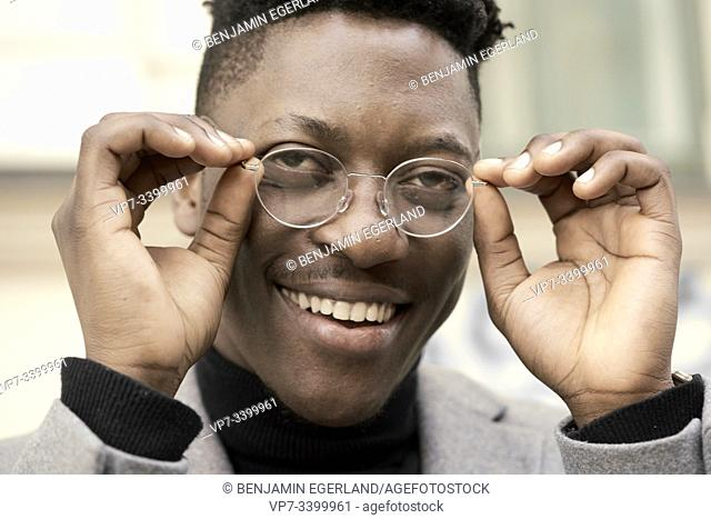 African man wearing glasses