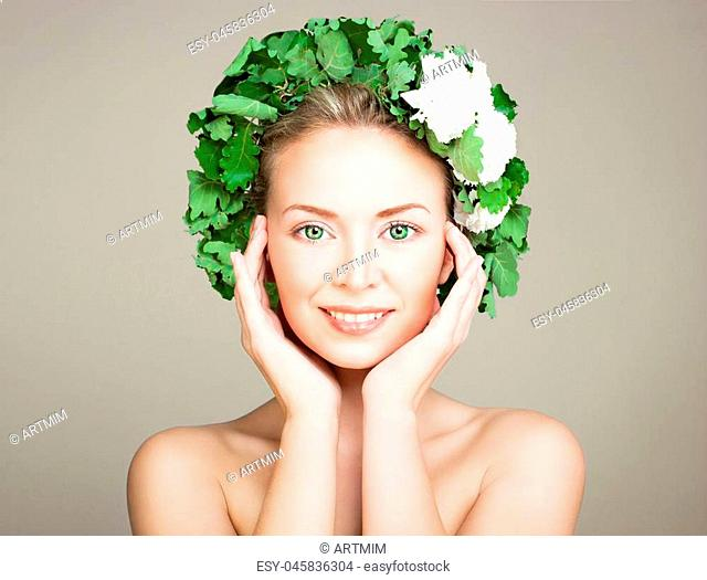 Smiling Woman Spa Model with Clear Skin, Green Eyes and Wreath of Oak Leaves