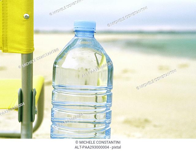 Bottle of water on beach