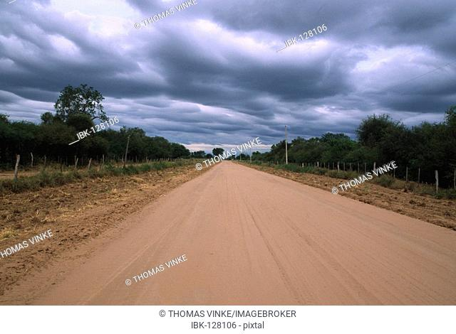 End of dry time: sky with deep clouds over a dirt road, Gran Chaco, Paraguay