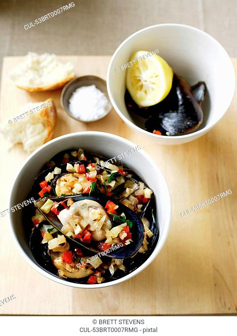 Bowl of mussels with capsicum salad