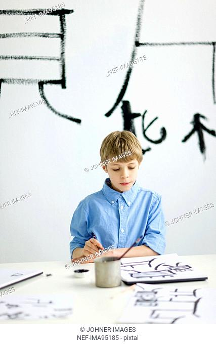 Boy and caligraphing chinese signs