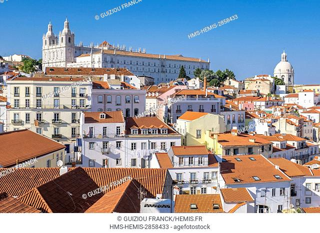 Portugal, Lisbon, view over the rooftops of the Alfama district, Sao Vicente de Fora monastery and Pantheon cupola from the terrace of Largo das Portas do Sol