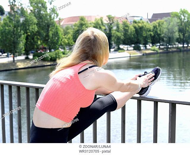 blond woman stretching