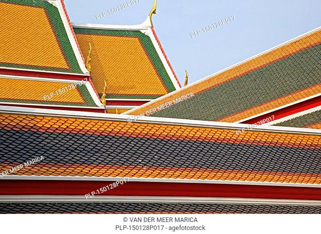 Colourful tiles on the rooftops of the Wat Pho complex / Temple of the Reclining Buddha, Buddhist temple in Phra Nakhon district, Bangkok, Thailand