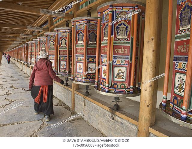 Tibetan pilgrim spinning prayer wheels, Xiahe, Gansu, China