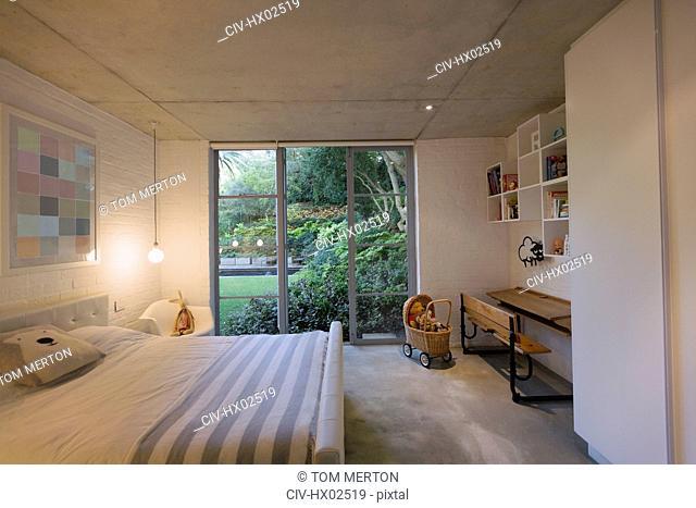 Home showcase interior child's bedroom open to garden