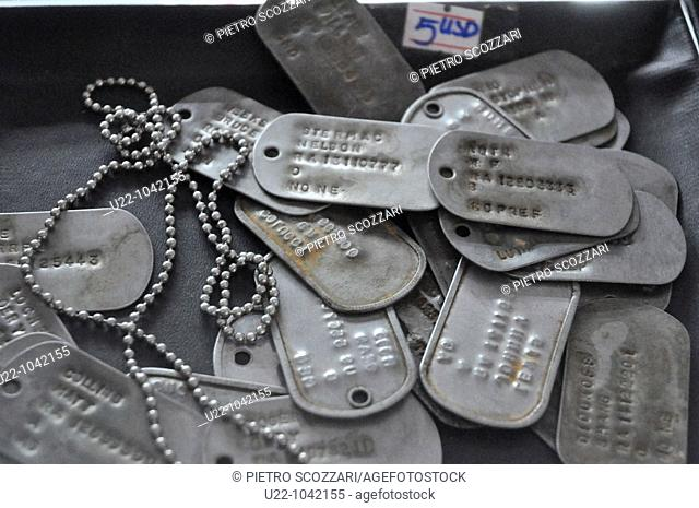 Ho Chi Min City (Vietnam): military identity discs sold as souvenirs at the  War Remnants Museum