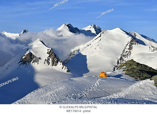 Camping with tent surrounded by Monte Rosa glaciers, Gobba di Rollin, Monte Rosa, Aosta Valley, Italy Europe