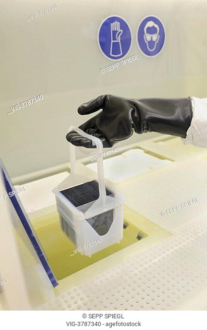 Germany, Gelsenkirchen, The Laboratory and Service Center (LSC) of the Fraunhofer Institute for Solar Energy Systems. The wafer blanks are etched with...