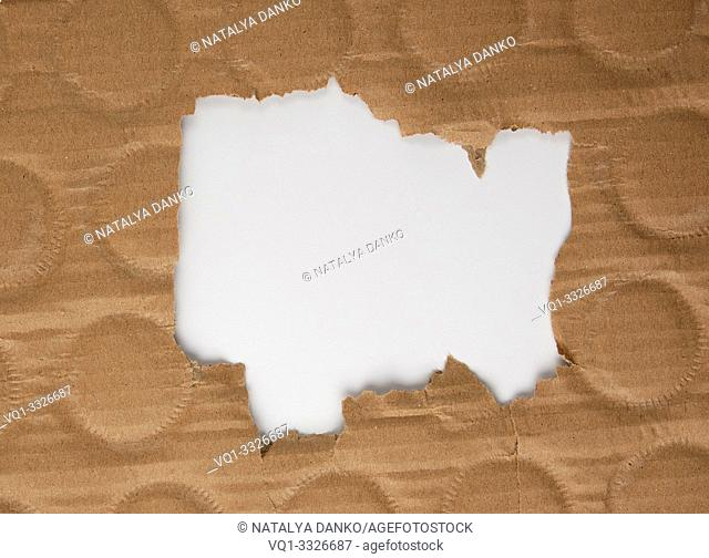 brown sheet of paper with a hole, full frame, white inside