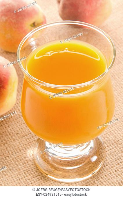 cold organic peach juice in a glass