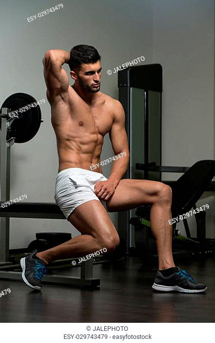 Portrait Of A Young Physically Fit Man Resting On Bench And Showing His Well Trained Body