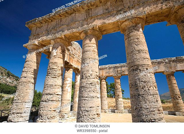 Low angle view of a section of the Doric temple at the ancient Greek city of Segesta, Calatafimi, Trapani, Sicily, Italy, Mediterranean, Europe
