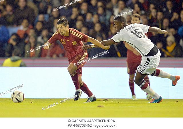 Germany's Antonio Ruediger (R) and Spain's Nolito vie for the ball during their soccer friendly match Spain - Germany at the Estadio Balaidos in Vigo, Spain
