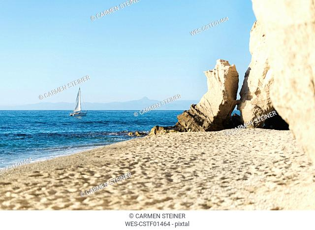 Italy, Calabria, Tropea, Tyrrhenian Sea, cave at beach, sandstone rock and sailing boat