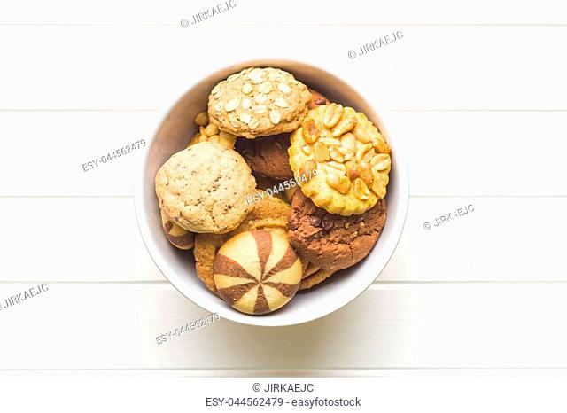 Different types of sweet cookies in bowl on kitchen table