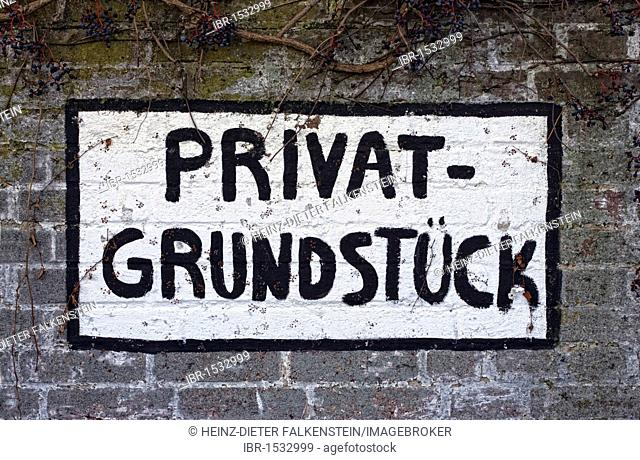Hand-painted sign, indicating 'Privatgrundstueck', private property
