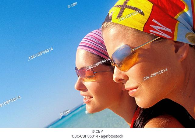 Portrait Of Two Young Women Wearing Bandanas At The Beach