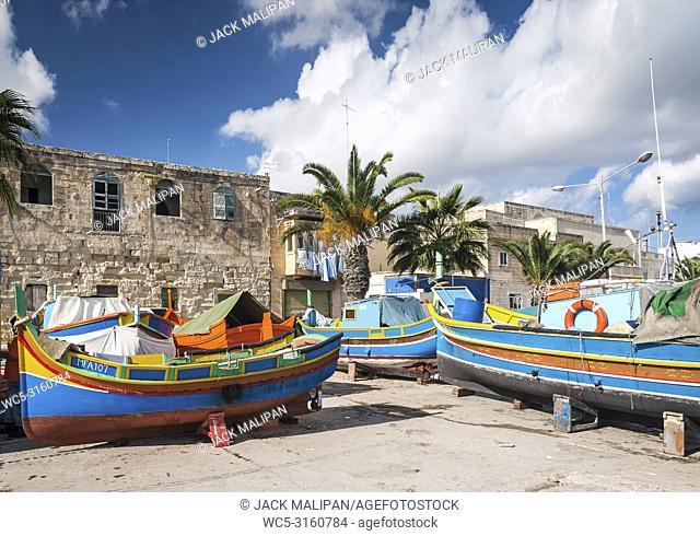 maltese traditional colorful painted luzzu boats in marsaxlokk fishing village malta
