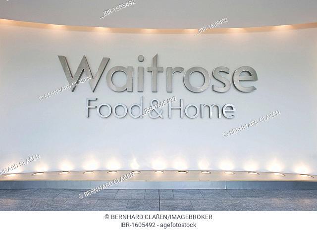 Logo at the entrance of a Waitrose supermarket, England, United Kingdom, Europe