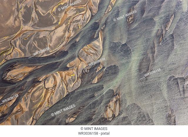 Aerial view of landscape with river coloured by glacial melt
