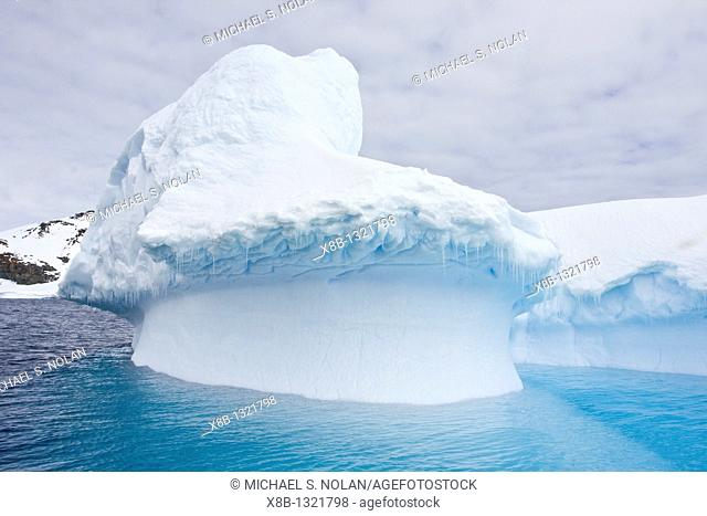 Wind and sea create fanciful iceberg designs near the Antarctic Peninsula during the summer months  More icebergs are being created as global warming is causing...