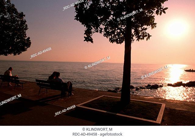 Promenade at sunset Bardolino Lake Garda Italy