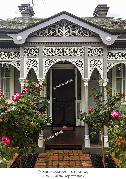 Intricate wrought iron lacework adorns the verandah of a Late Victorian-style house in suburban Ascot Vale, Melbourne, Australia