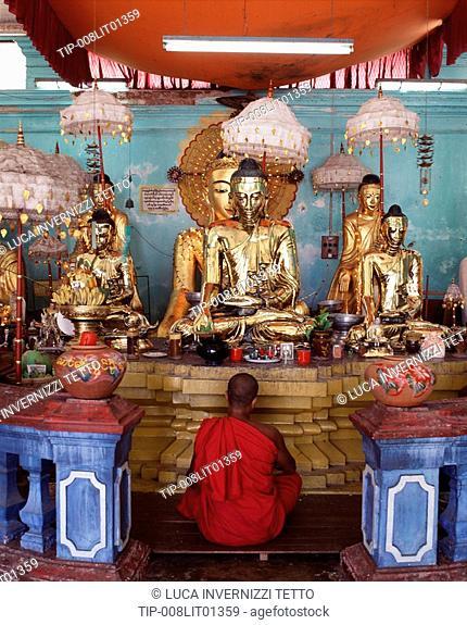 Monk meditating at the Shwedagon pagoda, Yangon. Burma