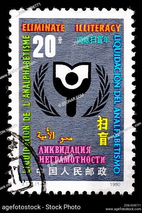 CHINA - CIRCA 1990: A Stamp printed in China shows image of Eliminate Illiteracy, circa 1990 CHINA - CIRCA 1990: A Stamp printed in China shows image of...