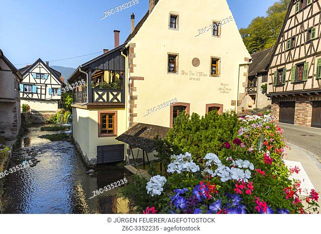 brook in the old village Andlau, Alsace Wine Route, France, ancient mill of the abbey