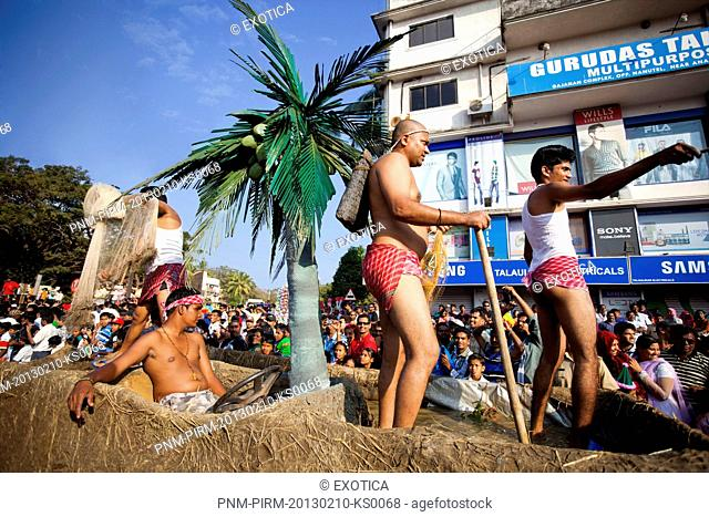 Glimpse showing fishermen at traditional procession in a carnival, Goa Carnivals, Goa, India