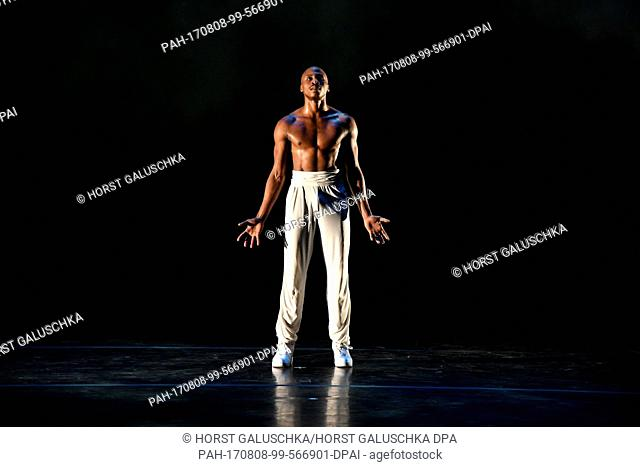 Dancers from the US dance company Alvin Ailey - American Dance Theater - dancing during a press call on stage at the Philharmonie concert hall as part of the...