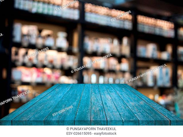 Blue tabletop wooden with blurred cafe background. product display template
