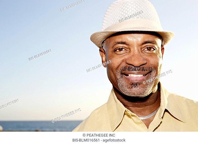 Black man smiling outdoors