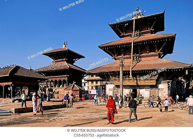 Nepal. Patan. Durbar Square. Vishwanath Temple, Temple built in 1627 has two large stone elephant guarding, Bhimsen Temple