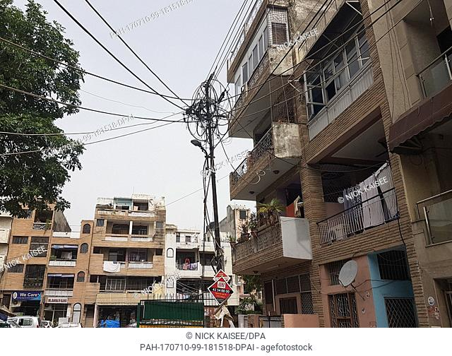 A power pole with completely tangled power cables can be seen in the city district Lajpat Nagar in New Dehli, India, 5 July 2017