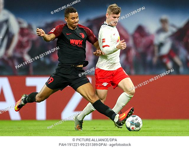 21 December 2019, Saxony, Leipzig: Football: Bundesliga, 17th matchday, RB Leipzig - FC Augsburg in the Red Bull Arena. Leipzig's Timo Werner (r) and Augsburg's...