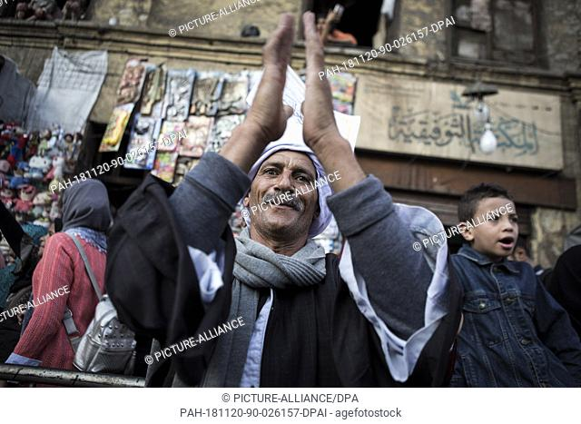 20 November 2018, Egypt, Cairo: A man takes part in a Sufis march at Al Hussein district, to mark the Mawlid al-Nabi al-Sharif
