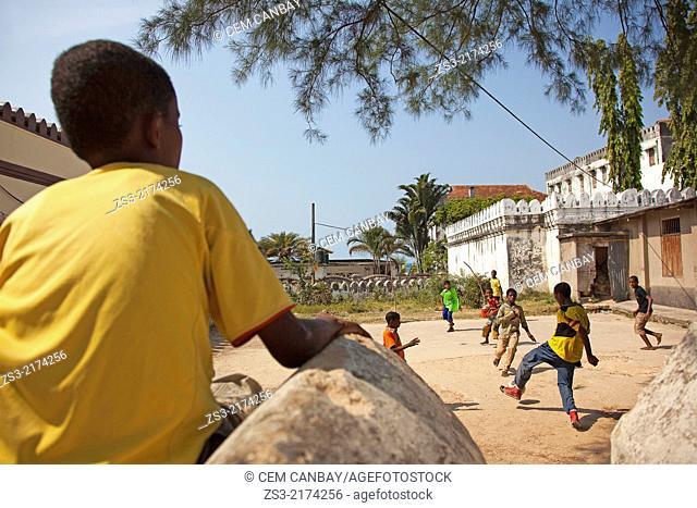 Boys playing football in the town center near Forodhani Gardens, Stone Town, Unguja Island, Zanzibar Archipelago, Tanzania, East Africa