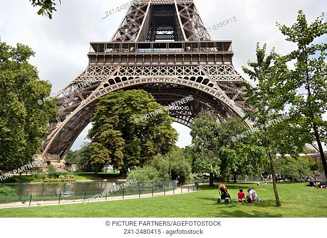 Relaxing under the Eiffel tower Paris France