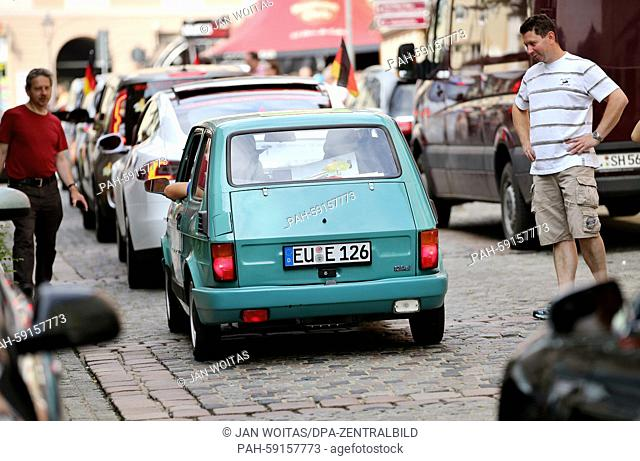 """The German team """"""""Solon"""""""" in their electrified Fiat 126, between modern Tesla and Co at the Wave Trophy in Plauen, Germany, 13 June 2015"""