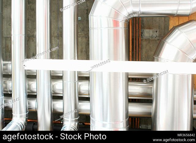chrome pipes in heating and AC rooms in buildings of factories and hospital. Several pipes with silver pipes