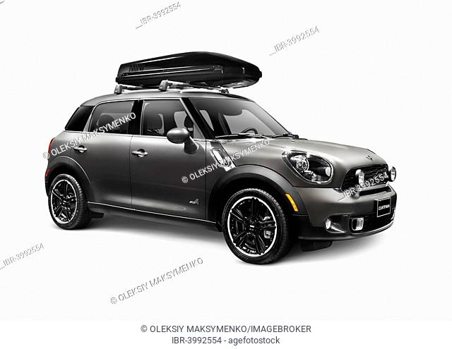 Gray 2014 Mini Cooper Countryman compact CUV car with a cargo roof box