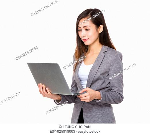 Businesswoman watch on the laptop computer