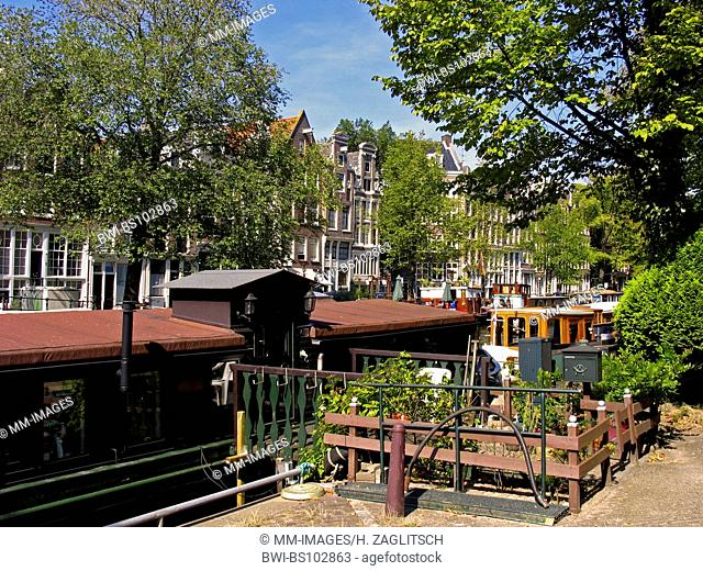 houseboat at a canal in Amsterdam, Netherlands