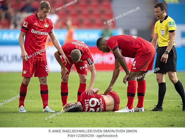 Kai HAVERTZ (LEV) injured on the ground, left to right Lars BENDER (LEV), Sven BENDER (LEV), Jonathan TAH (LEV) see after him, injury. Soccer 1