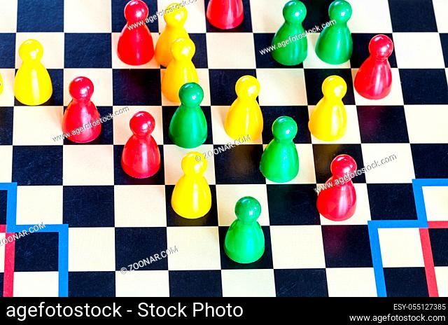 gameplay of Halma strategy board game close up. Halma board game was invented by George Howard Monks in1883-1884